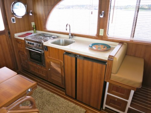 Well designed Euro-style galley with amazing overhead storage.